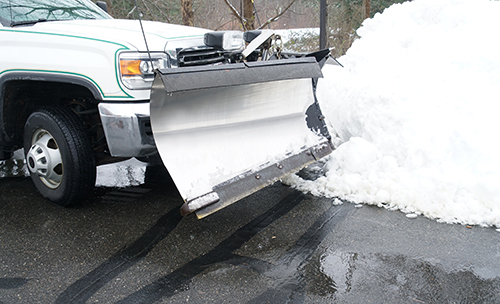 Snow plow in parking lot